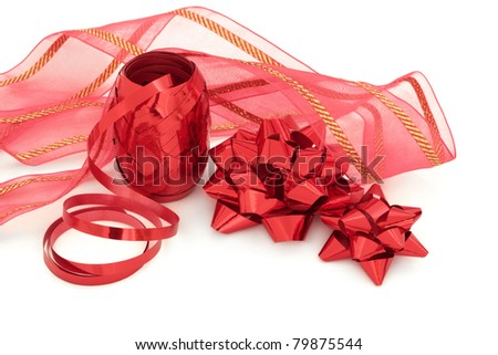 Red ribbon and bow gift decorations, isolated over white background.