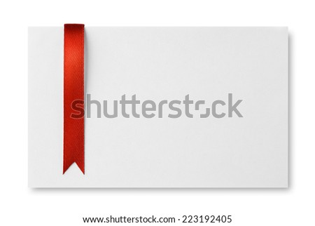 Red ribbon bookmark on empty paper card - stock photo