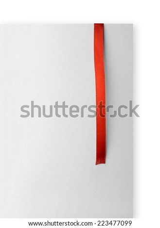 Red ribbon bookmark on empty paper card