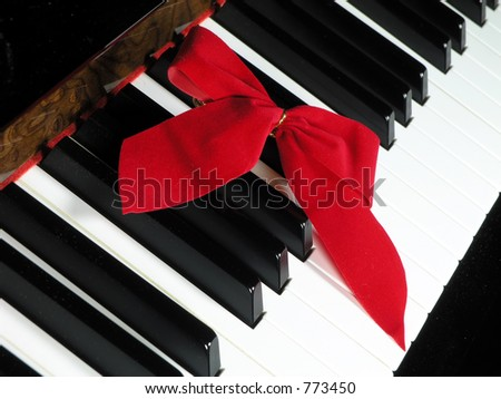 red ribbon bow over piano