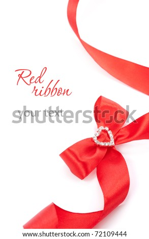 Red ribbon bow with heart on a white background - stock photo