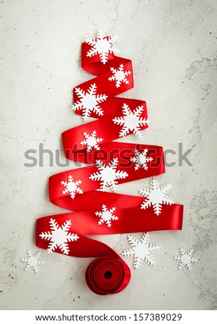 Red Ribbon Christmas Tree with decor on the cracked vintage background - stock photo