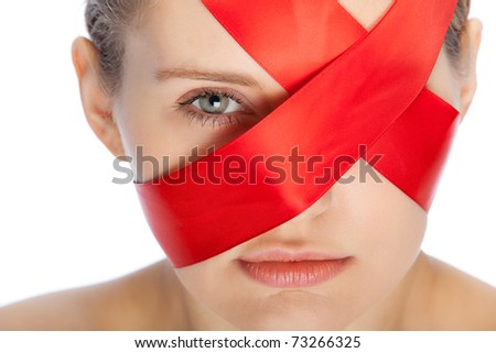 red ribbon covers face of a young woman - stock photo