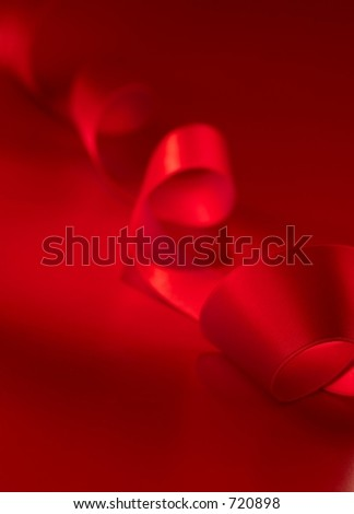 Red ribbon holiday background - stock photo