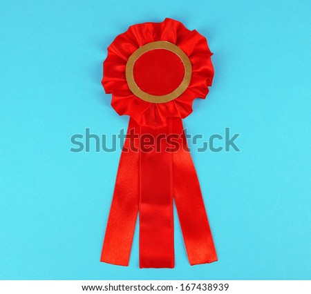 Red ribbon is symbol for success and  first prize, on color background - stock photo