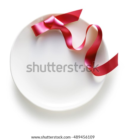 Red ribbon on white plate.