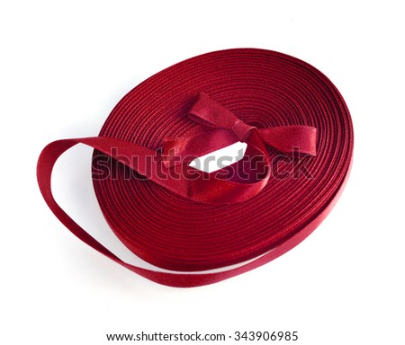Red ribbon roll on white background - stock photo