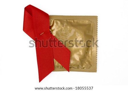 Red Ribbon with gold condom wrapper on a white background - stock photo