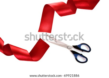 Red ribbon with scissors isolated on white - stock photo