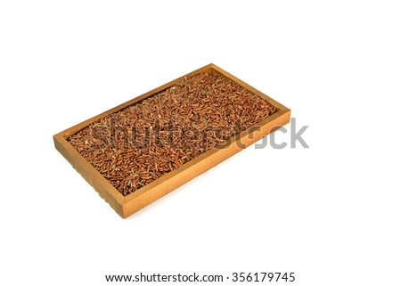 Red rice in  Wooden isolated on white background - stock photo