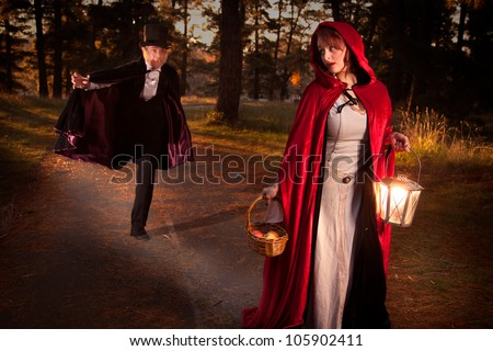 Red riding hood being chased by the big bad wold - stock photo