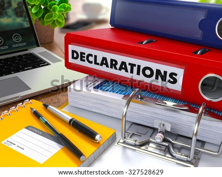 Red Ring Binder with Inscription Declarations on Background of Working Table with Office Supplies, Laptop, Reports. Toned Illustration. Business Concept on Blurred Background. - stock photo