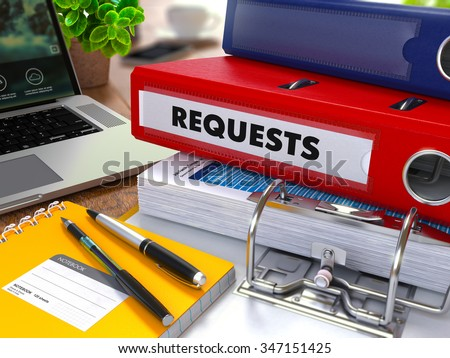 Red Ring Binder with Inscription Requests on Background of Working Table with Office Supplies, Laptop, Reports. Toned Illustration. Business Concept on Blurred Background. - stock photo