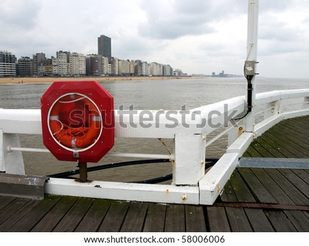 Red ring-buoy on a pier at Ostend, Belgium