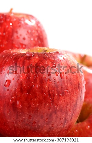 Red ripe apple wet with dewdrop of water  - stock photo
