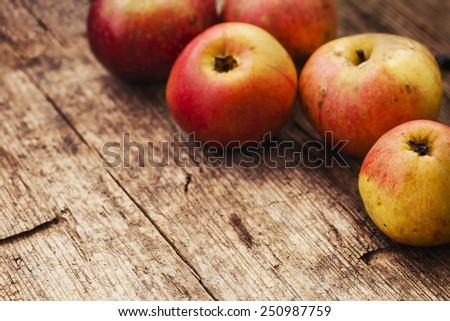 Red ripe apples on old wooden table background, Summer Autumn fruits - stock photo