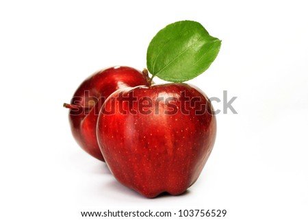 Red ripe apples on white - stock photo