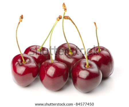 Red ripe cherries over white background