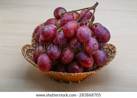 Red ripe grape on the wood background - stock photo