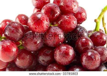 Red ripe grape with  drops of water. White background. - stock photo