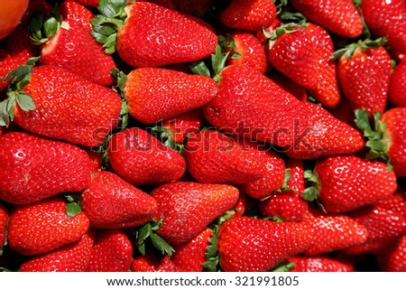 red ripe strawberries as background