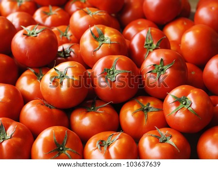Red ripe tomatoes background