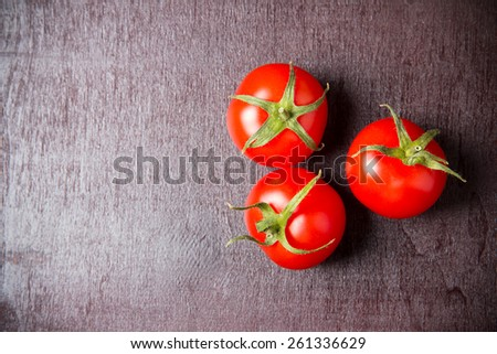 Red ripe tomatoes on a wooden surface. Top view - stock photo