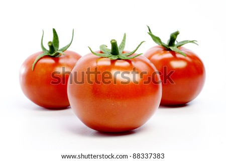 Red ripe tomatoes on white - stock photo