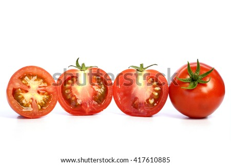 Red ripe tomatoes on white background - stock photo