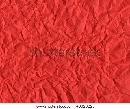 Red rippled paper background useful for Christmas greeting card
