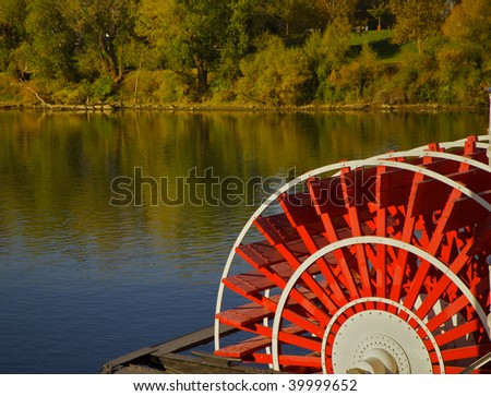 red river boat paddle wheel in water with trees - stock photo