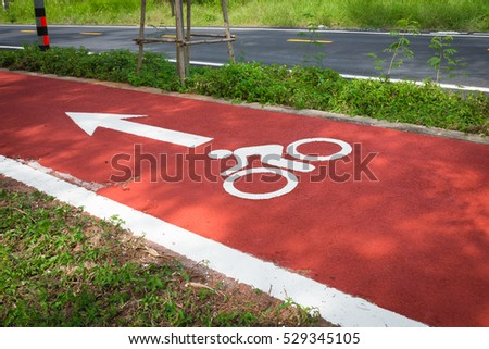 Red road and White bicycle road sign .Concept Cycling