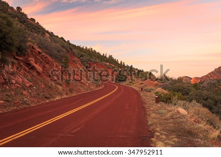 Red road in Zion at sunset, Utah, USA.