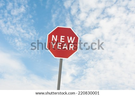 red road sign with a text of new year under blue sky