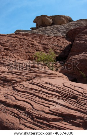 Red Rock Canyon National Conservation Area in Nevada is located about west of Las Vegas and showcases large red sandstone peaks and walls. - stock photo