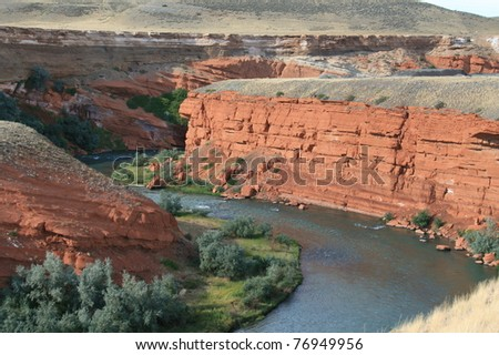 Red Rock canyon with a winding river - stock photo