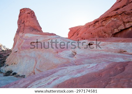 Red Rock Mountain with white swirls in the  Valley of Fire State Park in Nevada. - stock photo