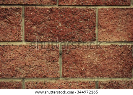 Red rock tile wall texture background close up. Vintage effect. - stock photo