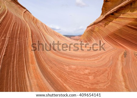 Red Rock Waves - Red swirling sandstone rocks at The Wave - a dramatic and colorful erosional sandstone rock formation located in North Coyote Buttes at Arizona-Utah border.  - stock photo