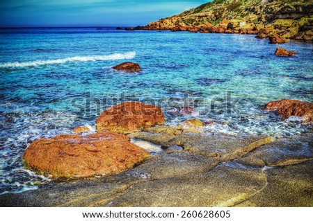 red rocks in Castelsardo shoreline. Processed for hdr tone mapping effect - stock photo