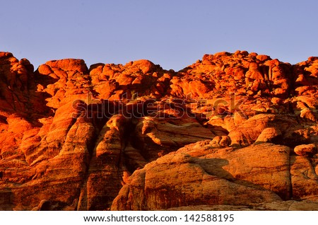 Red rocks in the evening light/Red Rock Park Nevada/Rocks are turned a deep red from sunlight - stock photo