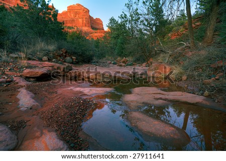 Red Rocks reflected in a creek - stock photo