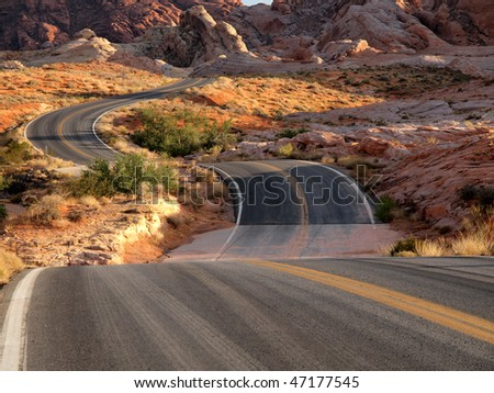 """Red rocks, """"S"""" curves and desert wash dips at Valley of Fire Nevada. - stock photo"""
