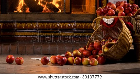 red rolling apples against the fire - stock photo