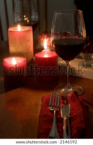 red & romantic dinner setting for two - stock photo