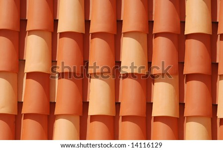 Red roof tile in the sun - stock photo