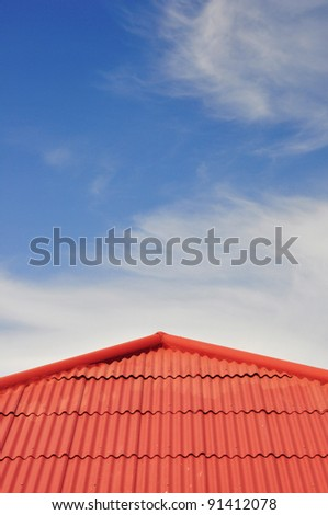 red roof tiles and cloudy sky on the background - stock photo