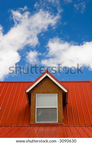 red roof under the sky - stock photo
