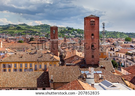 Red roofs and medieval towers in Old City of Alba in Piedmont, Northern Italy (view from above). - stock photo