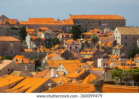 Red roofs and port of Dubrovnik from the old town walls, Croatia - stock photo